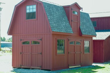 red 2 story storage shed